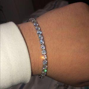 A stainless steel, diamond bracelet